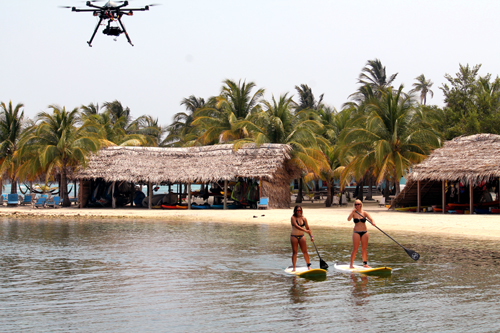 Jasmine and Alex paddle for the drone.