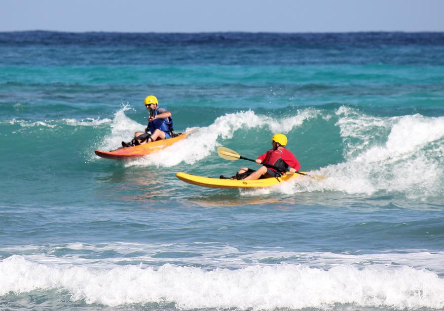 Surf kayak our wave at Glover's Reef, Belize