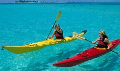 kayakers in belize near adventure island