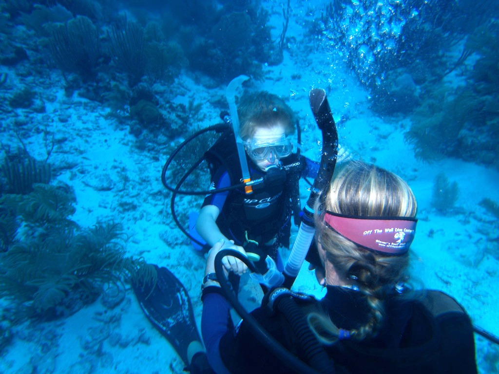 11 year old taking a scuba diving course at The Wall