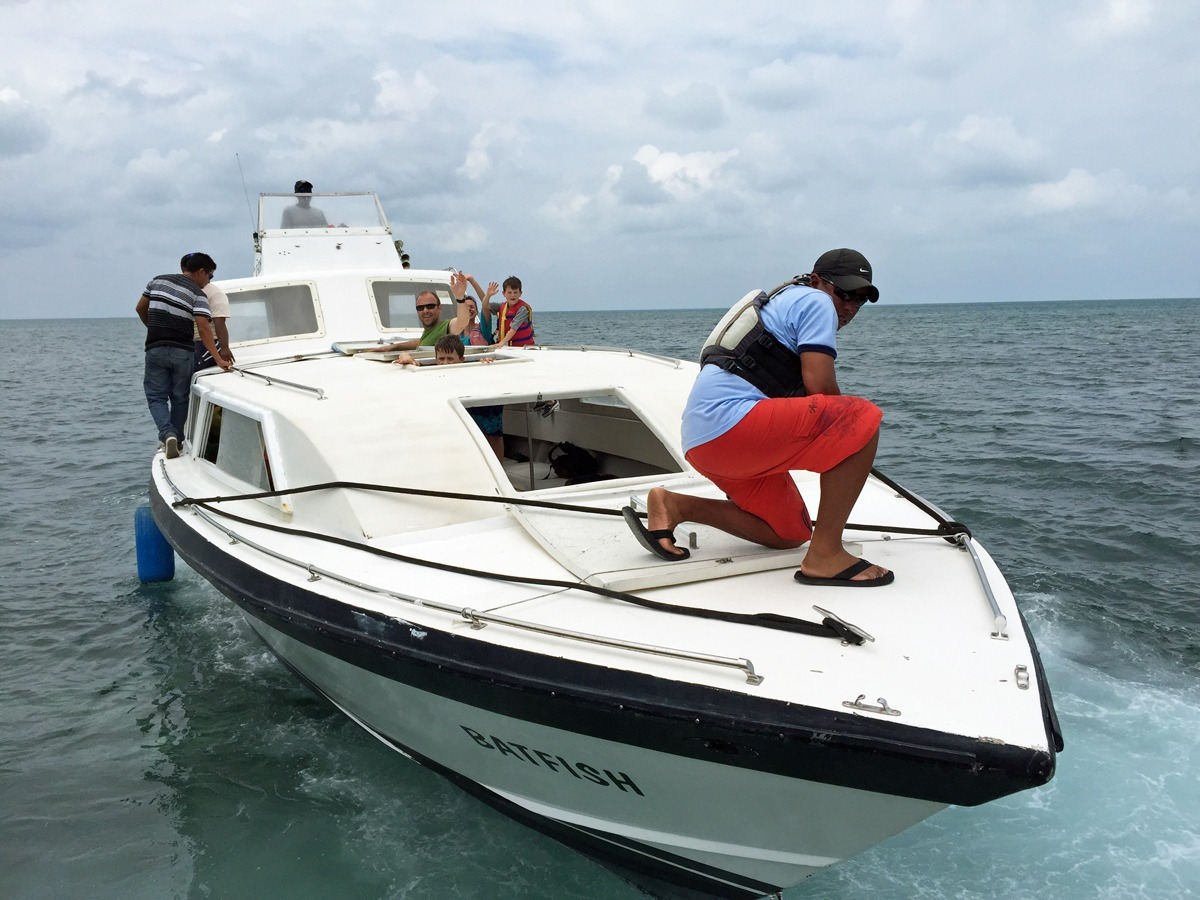 Our private boat charter arriving at Glover's Reef
