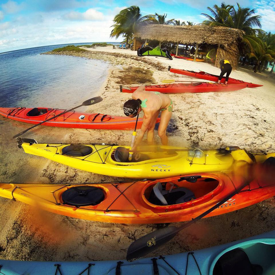 Preparing the kayaks for our first paddle out to snorkel at a nearby patch reef