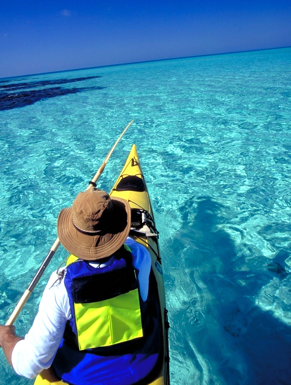 Paddling to Middle Caye, two-and-a-half miles from our island