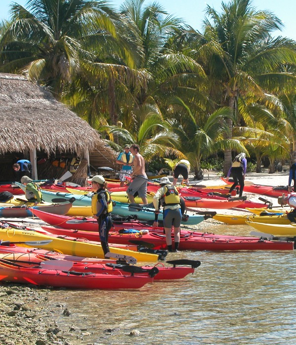 Launching our kayaks for a snorkeling expedition