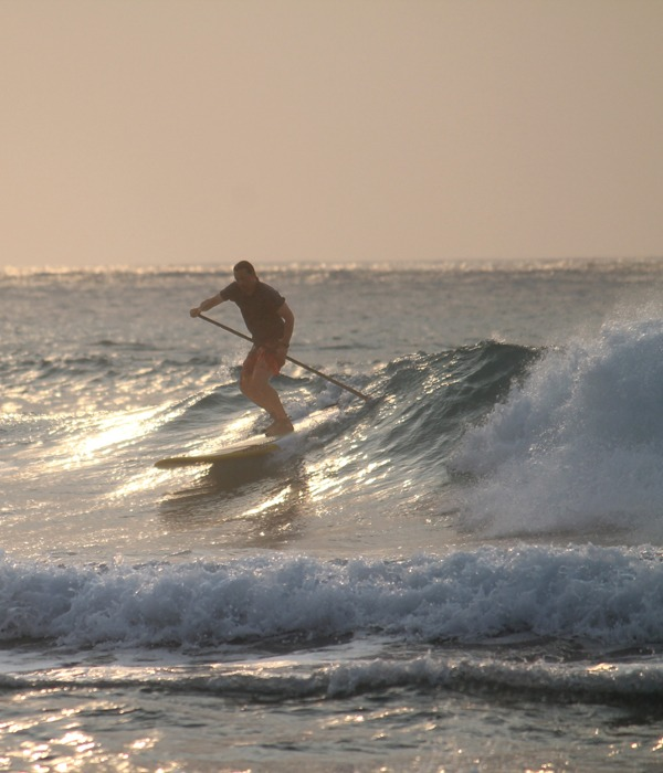 Surfing our private wave at dawn