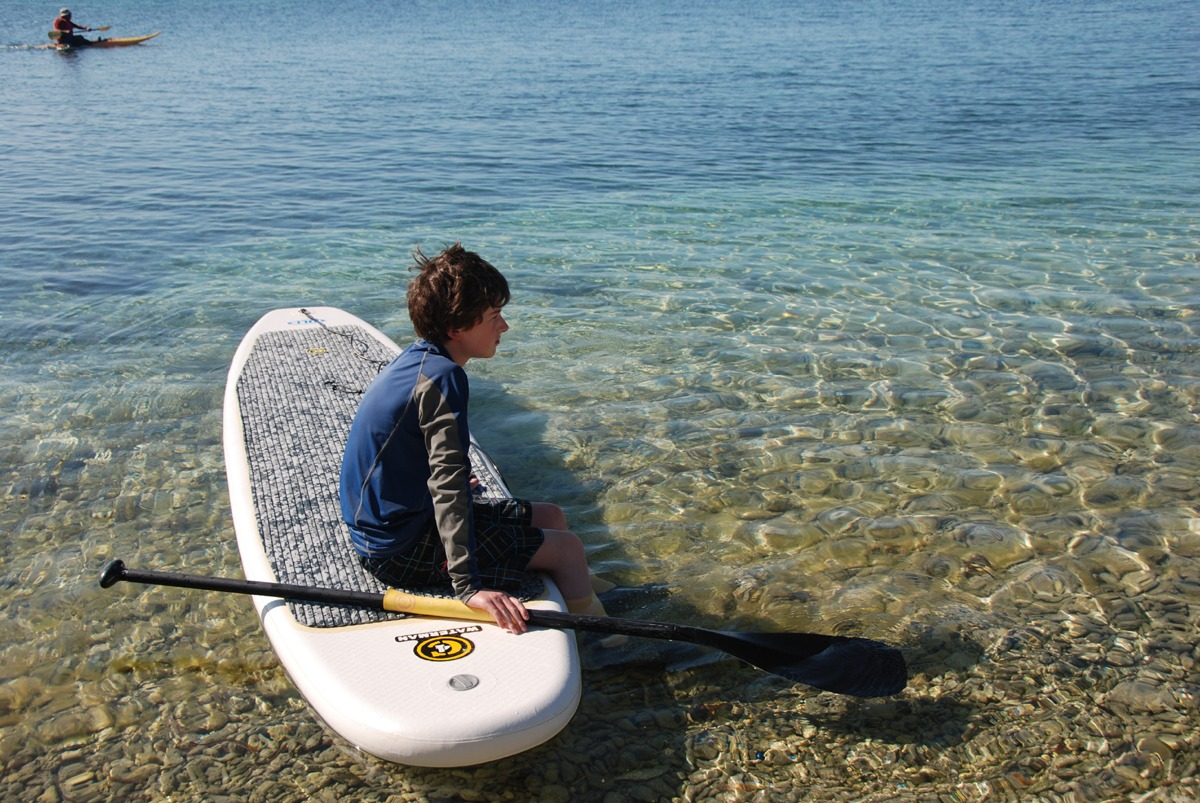 Your kids will have more success with paddleboard surfing rather than standard surfing