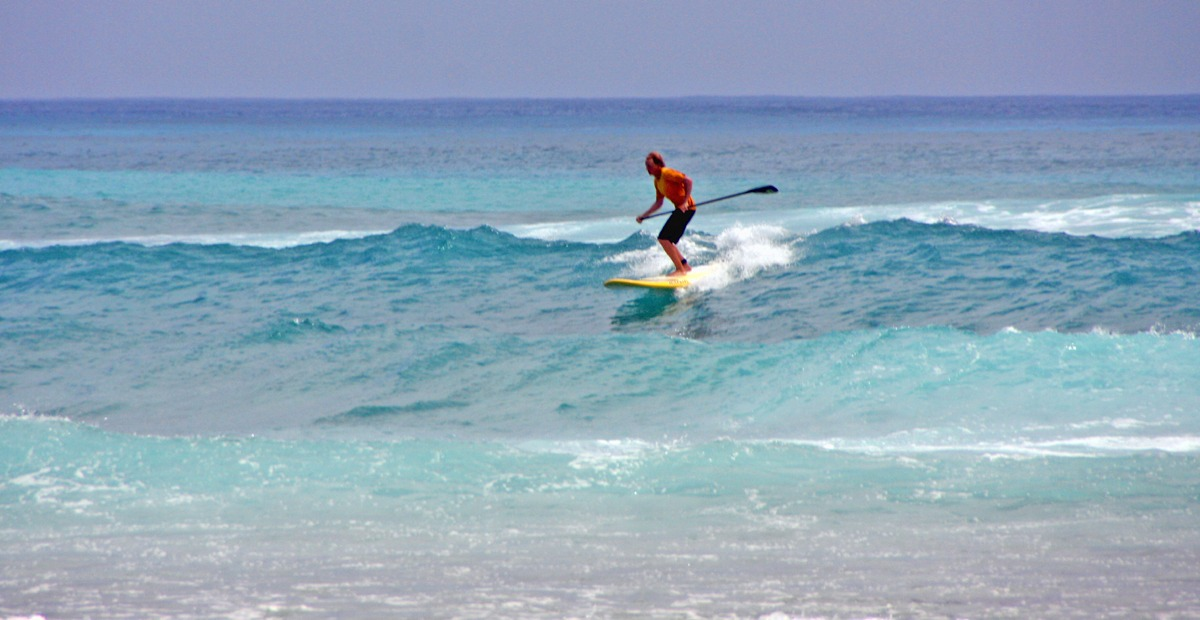 Surfing Long Caye's wave