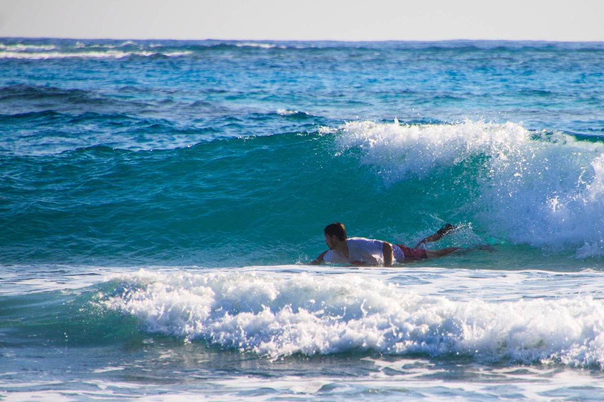Surfing in Belize is great, the water is 82 degrees!