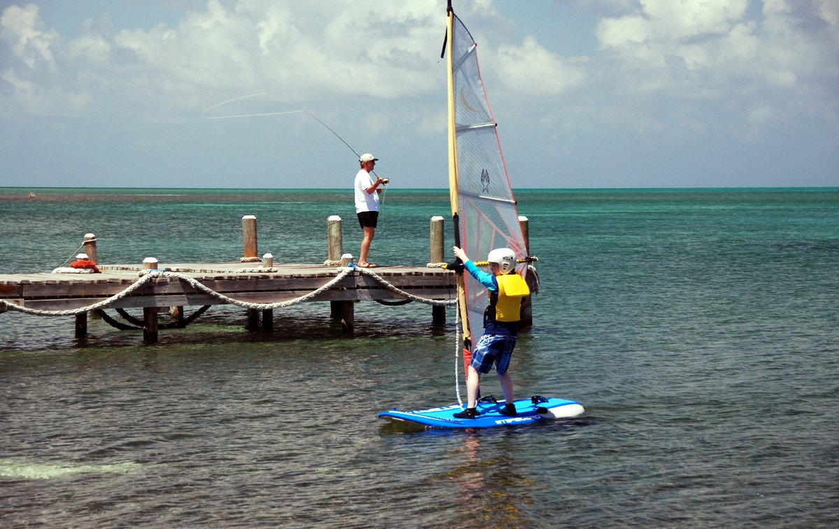 Kids and adults alike can learn to windsurf on our island in Belize