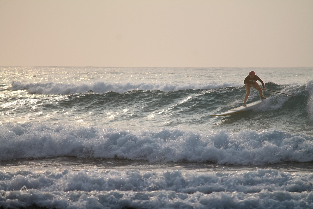 Surfing at dawn, Long Caye, Belize
