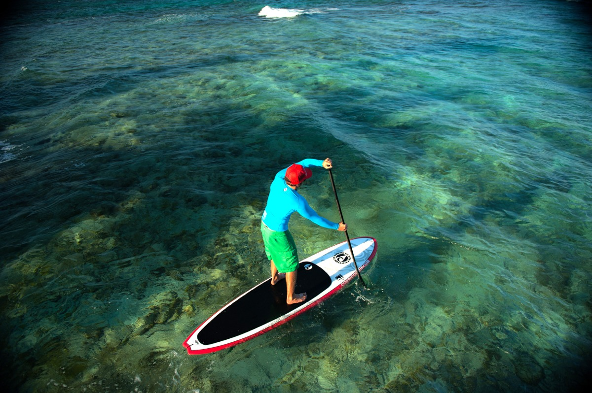 Learn to paddleboard in Belize, the water is 80 degrees!
