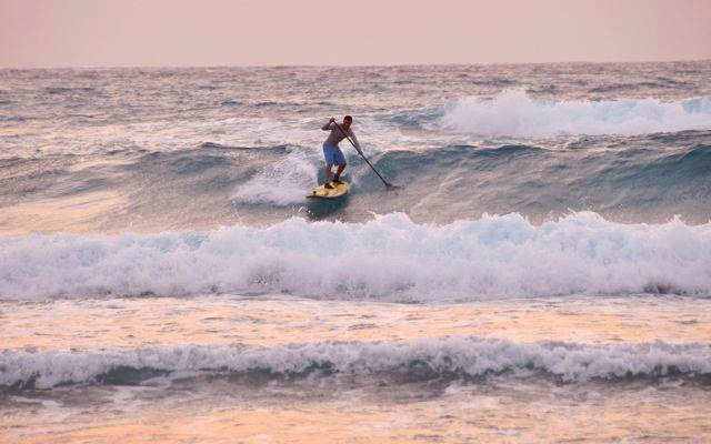 Dawn surf session, Long Caye at Glover's Reef, Belize