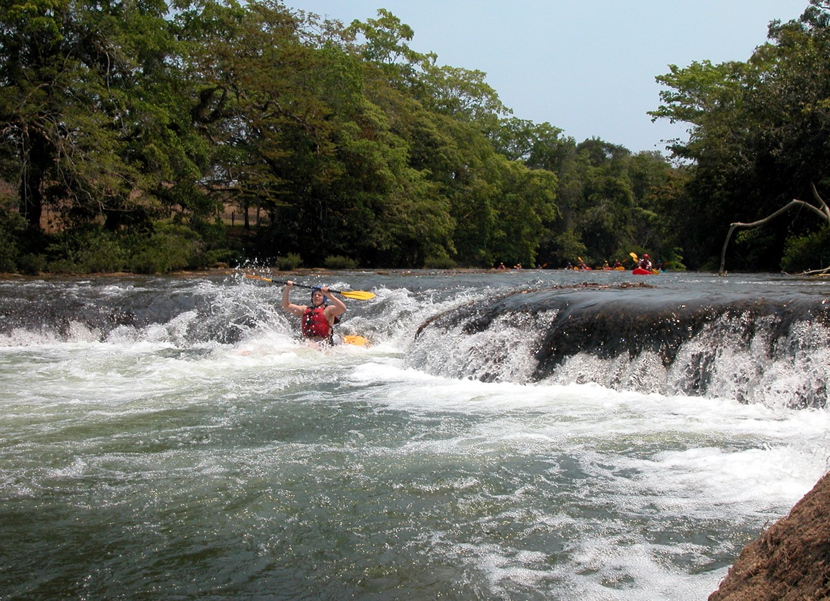 Running waterfalls in Belize by kayak