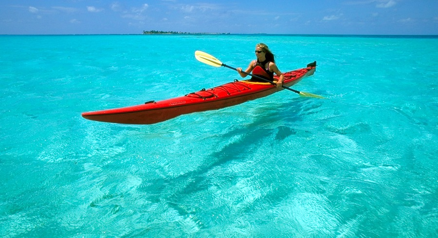 Kayak the aqua waters of Glover's Reef Atoll