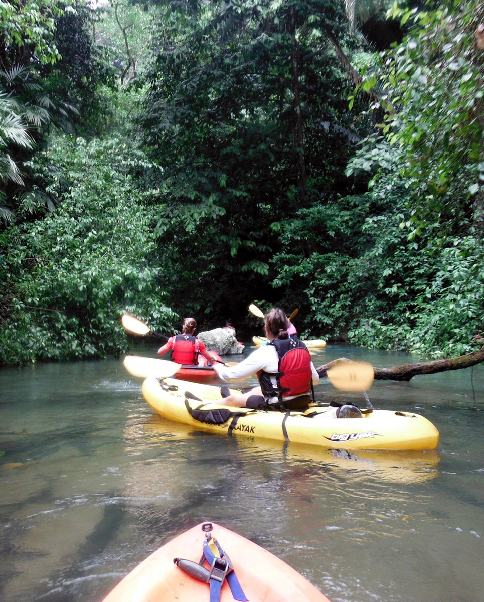 Paddling into one of the caves on the Caves Branch River