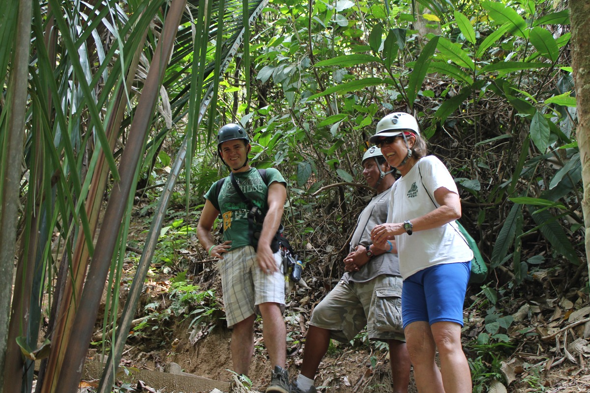 Hiking to the top of the waterfall to rappel off of it