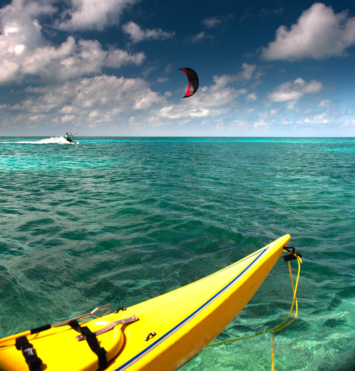 Sea kayaking and kiteboarding at the same location!