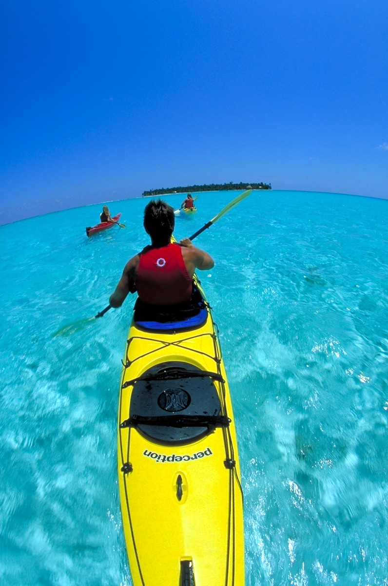 Paddling toward our island, Long Caye at Glover's Reef in Belize