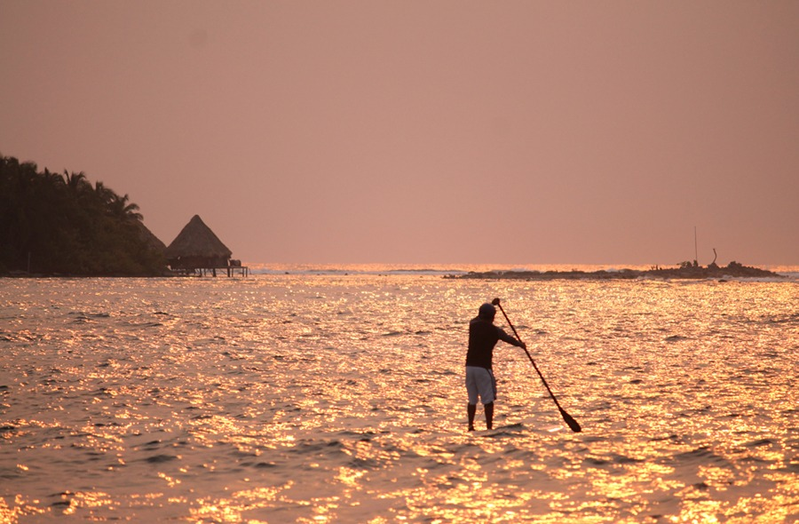Paddleboarding at dawn, Long Caye at Glover's Reef in Belize