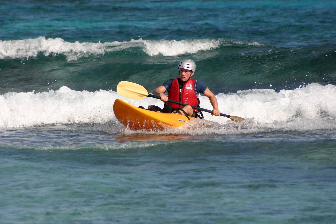Kayak surf wave in Belize, right off our shore
