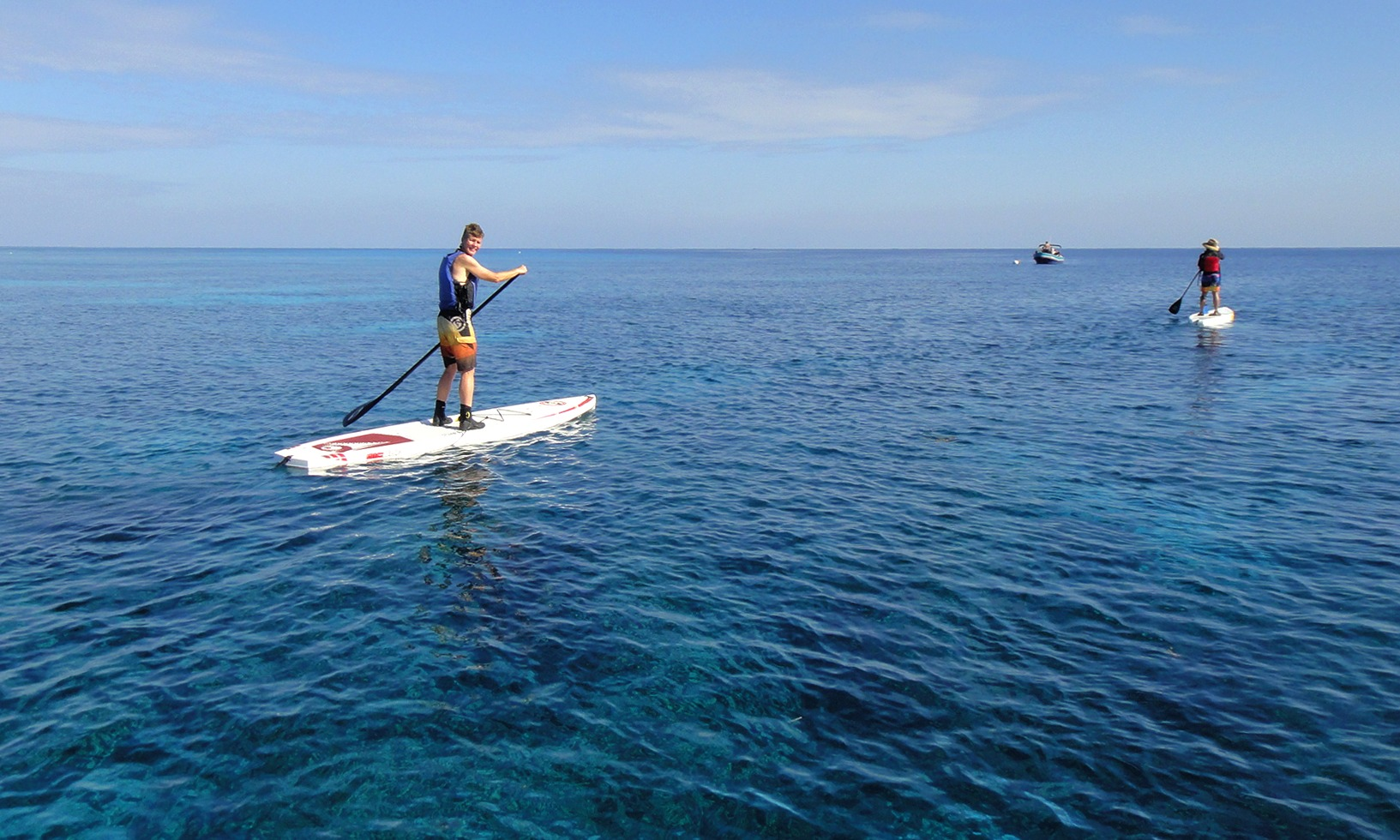 Paddleboarding to Middle Caye, Belize