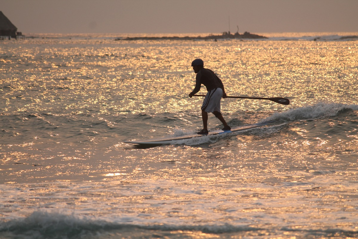 Surfing at dawn, Long Caye at Glover's Reef, Belize