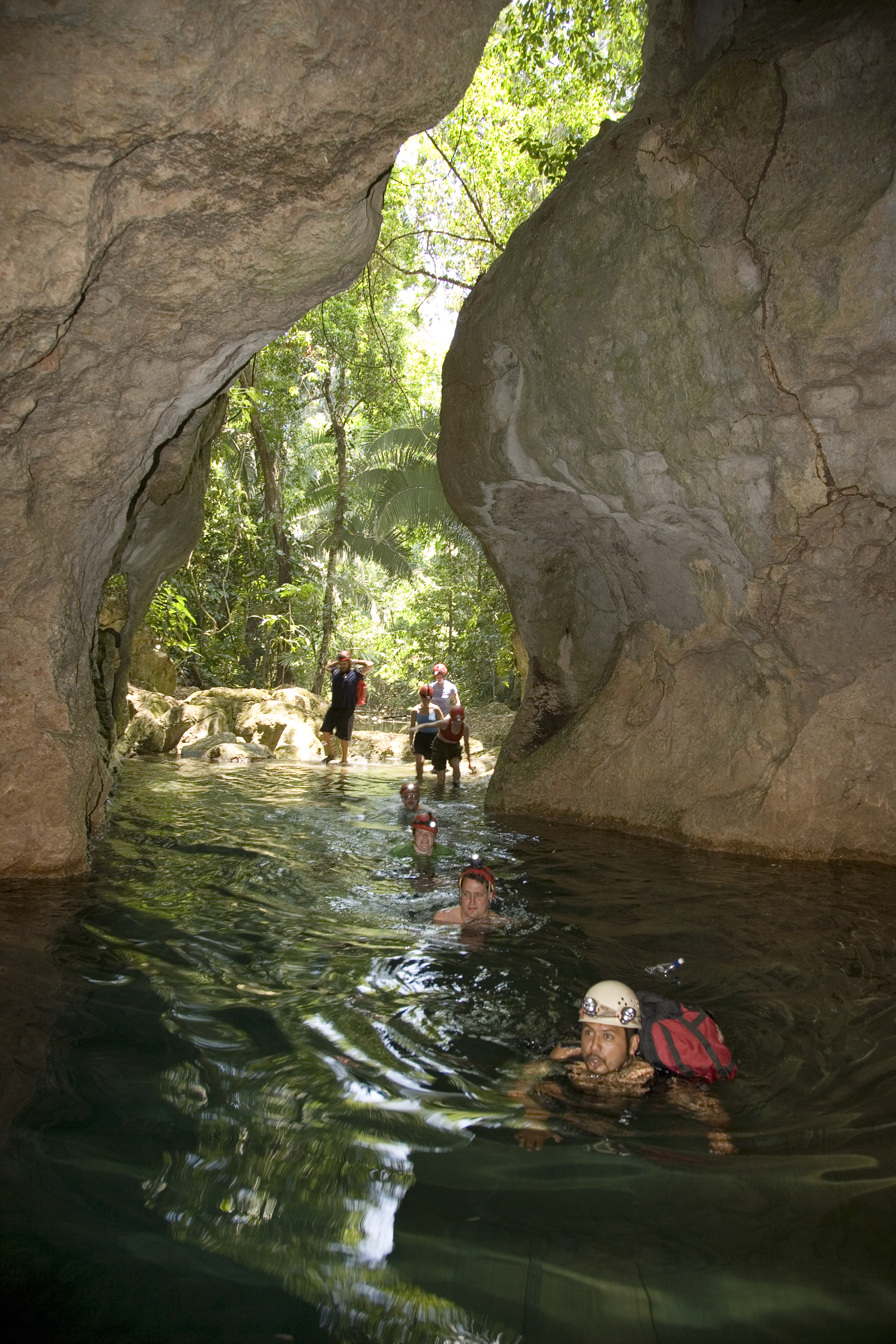 Swimming through the entrance to the ATM cave