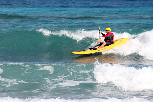 Surf kayaking in Belize