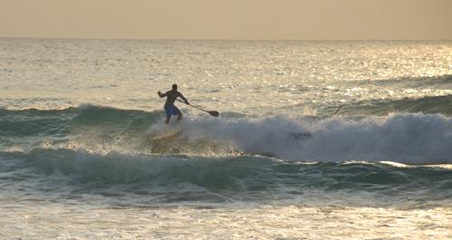 Belize paddleboard surfing