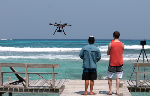 Jason lands the drone after a surf-filming session.