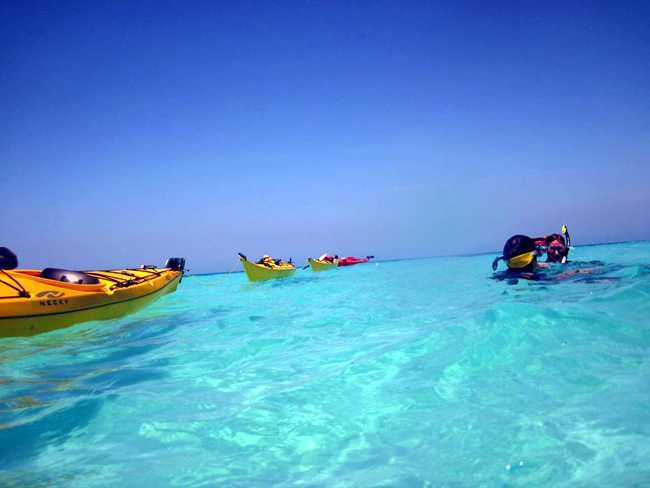 kayak snorkeling at glovers reef in belize